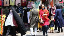 Iranians shop the capital Tehran yesterday during the coronavirus pandemic. Iran today lamented that
