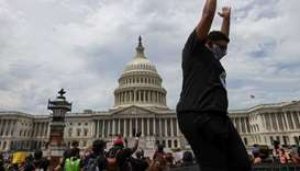 US crowds defy curfews to protest George Floyd's death, but violence subsides