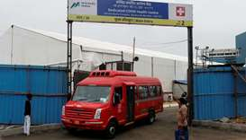 A bus carrying coronavirus disease (COVID-19) patients leaves a makeshift hospital to transport them
