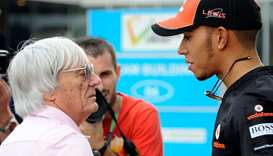 Lewis Hamilton (right) with Bernie Ecclestone. (AFP)