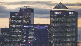 The offices of global financial institutions, including HSBC Holdings, stand in the Canary Wharf fin