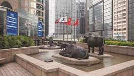 Sculptures displayed outside the Hong Kong Stock Exchange. The Hang Seng closed up 1.7% to 24,770.41