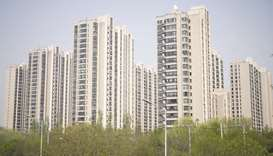 Residential buildings stand in the Taiyanggong area of Beijing. China kicked off a REIT trial in lat