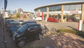 Parked automobiles are seen at a Toyota Motor Corporation dealership in London (file). Car dealershi