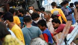 This picture taken earlier this week shows some men wearing face masks while the majority are not, o