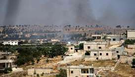smoke plumes rising following shelling by pro-Syrian government forces in the town of Banin, north o