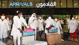 A delegation of Cuban medical personnel arrives at Kuwait International Airport early yesterday, to