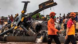 The wreckage of an Indonesian military MI-17 helicopter is seen at a crash site in Kendal, yesterday