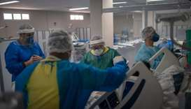 Health professionals take care of a patient at the IntensiveCare Unit (ICU) ward where patients infe