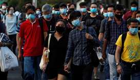 People cross a street during morning peak hour commute amid the coronavirus disease (COVID-19) outbr