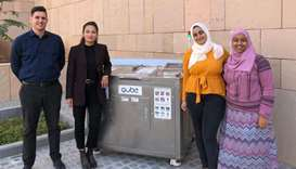 "Salma Hassan (second from right) next to the ""up-cycling"" machines introduced in the campus."
