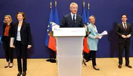 French Economy and Finance Minister Bruno Le Maire (C) addresses a press conference on the French go