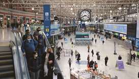 Commuters walk along the concourse after arriving at Waterloo railway station in London. The UK's ov