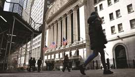 People are seen on Wall Street outside the New York Stock Exchange. Investors will be zeroing in on