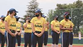 In this June 7, 2021, picture, members of Australia's Olympic softball squad listen to the mayor of