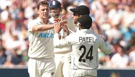 New Zealand's Matt Henry (left) celebrates with teammates after taking the wicket of England's Dom S