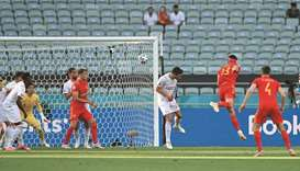 Wales' midfielder Kieffer Moore (second right) heads the ball to score during the UEFA Euro 2020 Gro
