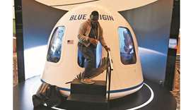 In this file photo taken on June 5, 2019, participants leave the Blue Origin Space Simulator during