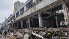 Rescuers work at a gas pipe explosion site in Shiyan, China
