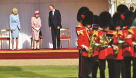 Queen Elizabeth with the Bidens in front of members of the Royal Guard, at Windsor Castle.