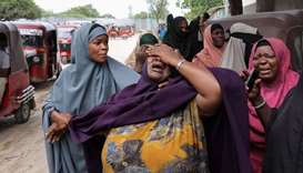 A woman reacts after receiving the confirmation that her son was killed in a suicide bombing attack