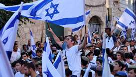 Israelis lift flags as they take part in the ultranationalist March of the Flags. AFP