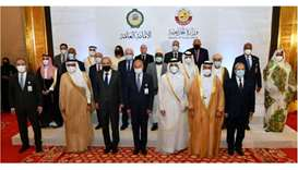 Participants of the meeting pose for a group picture in Doha on Tuesday. PICTURE Ramchand