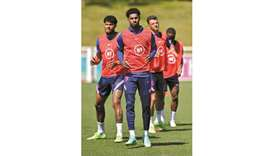 England's forward Marcus Rashford (centre) and his teammates take part in a training session at the