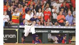 Jose Altuve of the Houston Astros hits a grand slam to defeat the Texas Rangers during the tenth inn