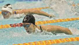 Emma McKeon leads in the women's 100m butterfly final during the Australian Olympic swimming trials
