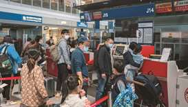 Travellers line up at Air China counters at Beijing Capital International Airport. Unruly passengers