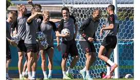 Denmark's players take part in an training session in Helsingor, north of Copenhagen, on the eve of