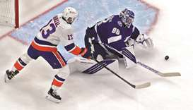 Andrei Vasilevskiy (right) of the Tampa Bay Lightning makes a save against Mathew Barzal of the New