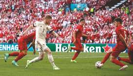 Belgium's Kevin De Bruyne (second left) scores against Denmark during the Euro 2020 Group B match at