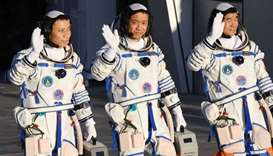 The first Tiangong crew includes astronauts Nie Haisheng (C), Liu Boming (R) and Tang Hongbo. (AFP)