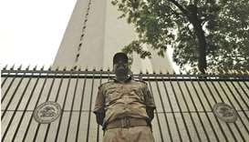 A security guard stands outside the Reserve Bank of India headquarters in Mumbai. The inflation shoc
