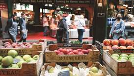 Apples for sale on display in Borough Market in London. The volume of goods sold in stores and onlin