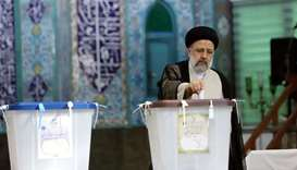 Presidential candidate Ebrahim Raisi casts his vote during presidential elections at a polling stati