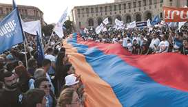 Supporters of the 'Armenia' bloc led by the country's former president Robert Kocharyan attend a cam