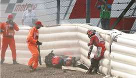 Ducati-Pramac rider Johann Zarco is assisted by track marshals after crashing during qualifying ahea