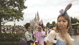Visitors attend celebrations for the 5th anniversary of the Shanghai Disneyland theme park at the re