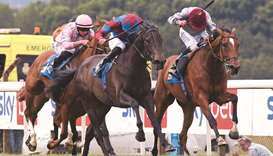 Ryan Moore (right) rides Katara to victory in the Pontefract Castle Fillies' Stakes in Pontefract, E