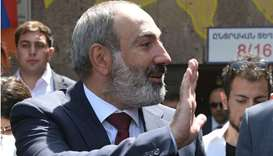 Armenia's acting Prime Minister Nikol Pashinyan waves as he walks to vote at a polling station durin