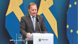 Prime Minister Stefan Loefven pauses at a news conference after the vote in Stockholm yesterday. (AF