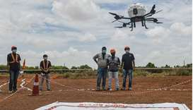 Technicians fly a drone belonging to the Throttle Aerospace Systems (TAS) which flies Beyond Visual