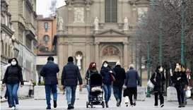 People walk at a street a year after the peak of Italy's coronavirus disease outbreak, in Bergamo, t