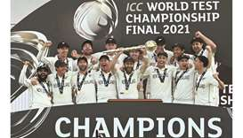 New Zealand's captain Kane Williamson lifts the winner's Mace as his teammates celebrate victory on