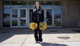 (File photo) Brandi Levy wears her former cheerleading outfit outside Mahanoy Area High School in Ma