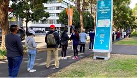 People wait in line outside a coronavirus disease (Covid-19) vaccination centre at Sydney Olympic Pa