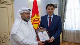 Ulukbek Maripov, Chairman of the Cabinet of Ministers , Kyrgyzstan, hands over a Certificate of Hono